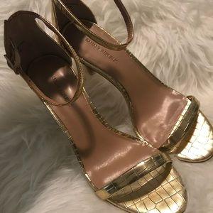 Slightly used gold banana republic strappy heel 7
